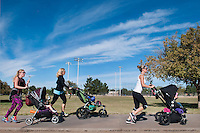 Fit4Mom francise owner Amy Feltus, center, works out with her moms, Hilary Cooper, and her son Emerson, 21 months, Scottsdale,  left, and Nita Bonilla, and Harper, 21 months, Scottsdale,  in one of their classes in northeast Phoenix. The class uses portable equipment strollers and park landscape to help moms fit a workout into their busy schedules and keep their fitness on track.