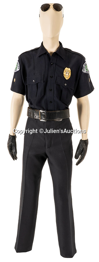 BNPS.co.uk (01202 558833)<br /> Pic: Juliens/BNPS<br /> <br /> George Michael's full LAPD ensemble...<br /> <br /> George Michael's iconic police outfit he wore in one of his most famous music videos to poke fun at his high profile brush with the law has emerged for sale for £16,000. ($20,000)<br /> <br /> The late singer can be seen dancing in the Los Angeles Police Department costume in his satirical 1998 video for 'Outside'.<br /> <br /> That April, he was caught engaging in a sexual act by an undercover officer in a Beverly Hills public toilet.<br /> <br /> The outfit consists of a navy blue police shirt with a gold badge attached, a pair of black leather gloves, a black leather belt and black sunglasses.<br /> <br /> It is being sold with Los Angeles based Julien's Auctions.