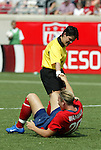 6 June 2004: Referee Clareth Jimenez Granados of Costa Rica (standing) helps Abby Wambach (below) get back to her feet in the first half. The United States tied Japan 1-1 at Papa John's Cardinal Stadium in Louisville, KY in an international friendly soccer game..