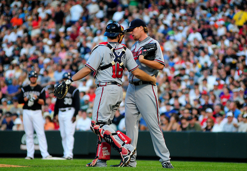 July 9, 2009: Braves catcher Brian McCann meets with starting pitcher and 2009 Rookie of the Year candidate Tommy Hanson during a regular season game between the Atlanta Braves and the Colorado Rockies at Coors Field in Denver, Colorado.