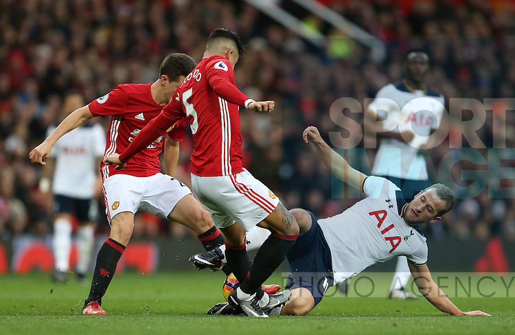 Harry Kane of Tottenham tackled by Marcos Rojo of Manchester United during the English Premier League match at Old Trafford Stadium, Manchester. Picture date: December 11th, 2016. Pic Simon Bellis/Sportimage