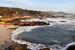 """The Ocean"" 17 Mile Drive, Pebble Beach. Sunset on the Pacific Ocean.  The Cypress trees lining the coastal rocks as the waves crash onto the beach just south of Carmel on a stretch of highway named 17 Mile Drive. This is one of the best stretches of Coastal Highway in all of California.  There is a lot more than just Golf at Pebble Beach."