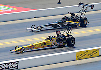 Apr. 14, 2012; Concord, NC, USA: NHRA top alcohol dragster driver Bill Reichert (near lane) races alongside Dan Mercier during qualifying for the Four Wide Nationals at zMax Dragway. Mandatory Credit: Mark J. Rebilas-