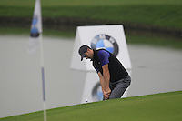 Ross Fisher (ENG) chips onto the 3rd green during Thursday's Round 1 of the 2014 BMW Masters held at Lake Malaren, Shanghai, China 30th October 2014.<br /> Picture: Eoin Clarke www.golffile.ie