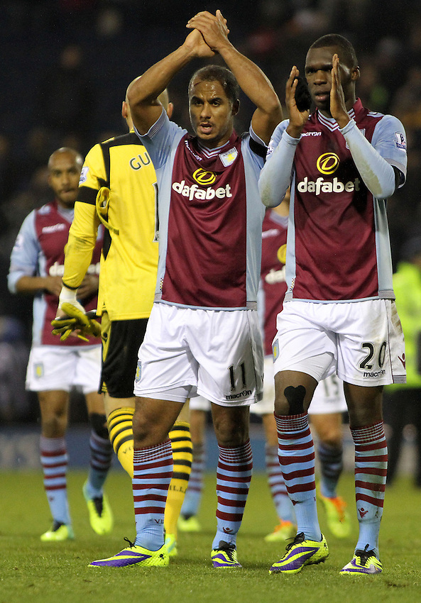 Aston Villa's Gabriel Agbonlahor and Christian Benteke applaud the crowd after the final whistle.<br /> <br /> Photo by James Marsh/CameraSport<br /> <br /> Football - Barclays Premiership - West Bromwich Albion v Aston Villa - Monday 25th November 2013 - The Hawthorns - West Bromwich<br /> <br /> &copy; CameraSport - 43 Linden Ave. Countesthorpe. Leicester. England. LE8 5PG - Tel: +44 (0) 116 277 4147 - admin@camerasport.com - www.camerasport.com