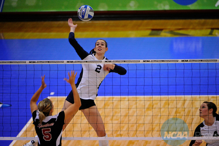 04 DEC 2010:  Cassie Haag (2) of Concordia St. Paul spikes the ball against Tampa during the Division II Women's Volleyball Championship held at Knights Hall on the Bellarmine campus in Louisville, KY.  Josh Duplechian/NCAA Photos