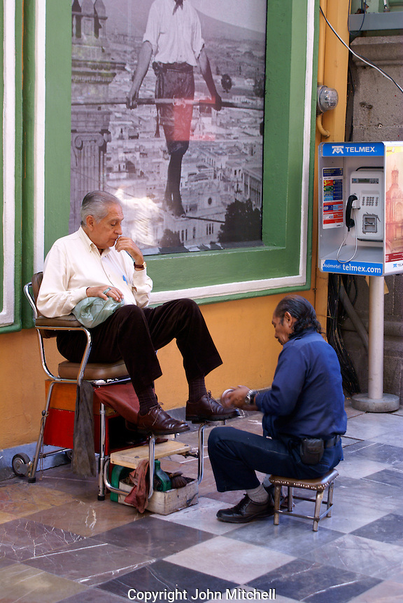 Man getting a shoe shine in the city of Puebla, Mexico. The historical center of Puebla is a UNESCO World Heritage Site.