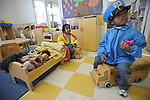 Damarion Jaelks, 2, and Legend Minter-Bey, 3, play together in Room 129 at the Educare Early Childhood Center in Chicago on November 21, 2008.  The pre-K daycare center is a model for head start, funded privately by the Gates and other foundations, that cares for and educates infants, toddlers, and 3- and 4-year old pre-school children.