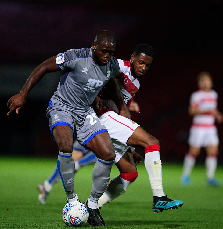 Lincoln City's John Akinde is fouled by Doncaster Rovers' Cameron John for a penalty<br /> <br /> Photographer Andrew Vaughan/CameraSport<br /> <br /> EFL Leasing.com Trophy - Northern Section - Group H - Doncaster Rovers v Lincoln City - Tuesday 3rd September 2019 - Keepmoat Stadium - Doncaster<br />  <br /> World Copyright © 2018 CameraSport. All rights reserved. 43 Linden Ave. Countesthorpe. Leicester. England. LE8 5PG - Tel: +44 (0) 116 277 4147 - admin@camerasport.com - www.camerasport.com