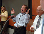 MELVILLE,NY-MONDAY APRIL 16, 2007: Newsday Cartoonist, Walter Handelsman celebrating with his coworkers at an acknowlegement ceremony for his winning of the Pulitzer for a Portfolio of Editorial Cartoons, in the Auditorium of Newsday offices in Melville on Monday April 16, 2007. Photo by/Jim Peppler.