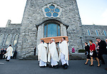 The coffin is carried from the cathedral to a crypt, by priests following the funeral mass of Bishop Eamonn Casey in Galway. Photograph by John Kelly.