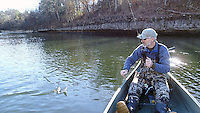 NWA Democrat-Gazette/FLIP PUTTHOFF <br /> Bruce Darr catches a rainbow trout Dec. 30 2016 from the White River below Beaver Dam. A float from the dam to Houseman Access makes a fine 7-mile paddling and fishing trip.