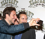 Bradley Cooper and Alessandro Nivola attends the 'The Elephant Man' Broadway Cast photo call at Sardi's on October 21, 2014 in New York City.