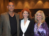 NWA Democrat Gazette/JOCELYN MURPHY<br /> David and Traci Sowersby (left) visit with Carenda Cobb at the annual Brandon Burlsworth Legends Dinner, hosted at the Fort Smith Convention Center on Friday, Oct. 20, 2016.