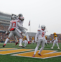 Ohio State Buckeyes running back Jalin Marshall (17) and Ohio State Buckeyes wide receiver Michael Thomas (3) celebrates Marshall's touchdown catch against Minnesota Golden Gophers during the 1st quarter at TCF Bank Stadium in Minneapolis, Minn. on November 15, 2014.  (Dispatch photo by Kyle Robertson)