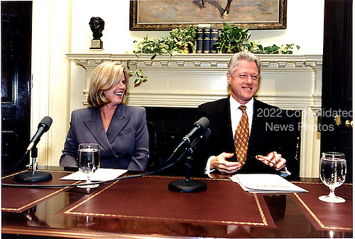 United States President Bill Clinton and Mrs. Al Gore (Tipper) tape the weekly radio address in the Roosevelt Room of the White House in Washington, D.C. on Friday afternoon, November 13, 1998.  They discussed Mrs. Gore's trip to Central America and announced new steps the United States will take to assist in disaster relief efforts in Honduras and Nicaragua..Mandatory Credit: Ralph Alswang / White House via CNP