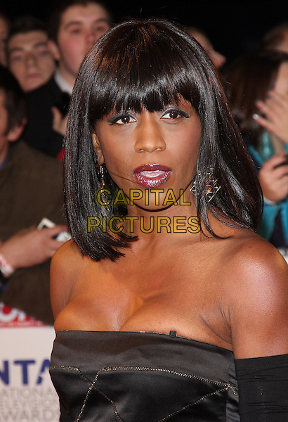DIANE PARISH.National Television Awards at the O2 Arena, London, England..January 26th 2011.NTA NTAs headshot portrait black strapless cleavage tight fringe bangs hair .CAP/ROS.©Steve Ross/Capital Pictures