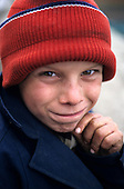 Poti, Georgia. Smiling boy in a red wooly hat.