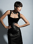 Beautiful asian model in black leather dress with short hair