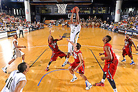 21 January 2012:  FIU center Brandon Moore (22) pulls down a rebound over FAU guard Alex Tucker (5) and guard Pablo Bertone (25) in the second half as the Florida Atlantic University Owls defeated the FIU Golden Panthers, 66-64, at the U.S. Century Bank Arena in Miami, Florida.