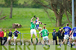 Peter Crowley Laune Rangers punches the ball out of St Brendan's Liam O'Sullivan grasp during their County Championship game in Killorglin Saturday evening