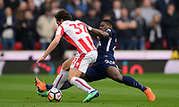 Serge Aurier of Tottenham  makes a tackle on Ramadan of Stoke during the EPL - Premier League match between Chelsea and West Ham United at Stamford Bridge, London, England on 8 April 2018. Photo by PRiME Media Images.