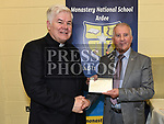 Tony Melia chairperson of the Parish Pastoral Council makes a presentation to Canon Peter Murphy who was celebrating 40 years in the priesthood. Photo:Colin Bell/pressphotos.ie