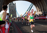 17 APR 2011 - LONDON, GBR - Raymond Butler crosses Tower Bridge during the London Marathon (PHOTO (C) NIGEL FARROW)