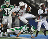 Clarke No. 21 Aaron Dawson tries to stay on his feet during a Nassau County varsity football Conference IV semifinal against Seaford at Hofstra University on Thursday, Nov. 12, 2015. <br /> <br /> James Escher