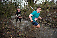 06 FEB 2011 - SIBBERTOFT, GBR - Alan Storrow (right) leads Paul Kerr through the brook during the Avalanche Adventure Run .(PHOTO (C) NIGEL FARROW)