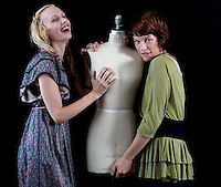 Mila Jovovich (at right) poses for a portrait along with her business partner as they unveil their new line of clothing.