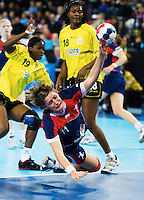 23 NOV 2011 - LONDON, GBR - Britain's Lyn Byl (#11, in blue) dives over the 6m line to shoot during the 2011 London Handball Cup match against Angola at The Handball Arena in the Olympic Park in Stratford, London  (PHOTO (C) NIGEL FARROW)