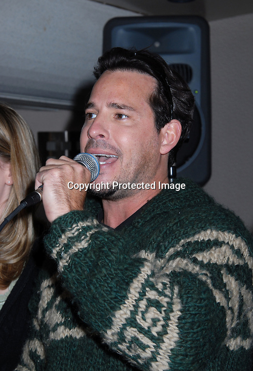Ricky Paull Goldin singing..at The Gus Bus Harbor Cruise on October 15, 2006 on World Yacht Boat Temptress.                                         Robin Platzer, Twin Images