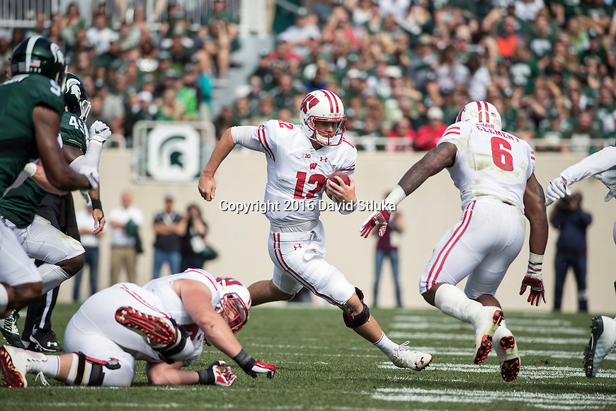 Wisconsin Badgers quarterback Alex Hornibrook (12) carries the ball during an NCAA college football game against the Michigan State Spartans Saturday, September 24, 2016, in East Lansing, Michigan. The Badgers won 30-6. (Photo by David Stluka)