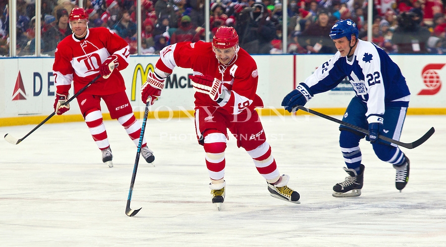 31 December 2013: Former Detroit Red Wings forward Sergei Fedorov (91) and Former Toronto Maple Leafs forward Tiger Williams (22) follow the puck, during the Toronto Maple Leafs v Detroit Red Wings Alumni Showdown hockey game, at Comerica Park, in Detroit, MI.