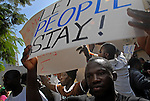Men during a large protest march, in which hundreds of African asylum seekers marched through the streets of Tel Aviv, calling Israeli authorities to grant them asylum.