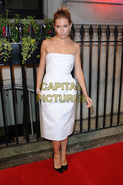 Sienna Miller <br /> The BFI Luminous Gala, London, England.<br /> 8th October 2013<br /> full length white dress<br /> CAP/BEL<br /> &copy;Tom Belcher/Capital Pictures