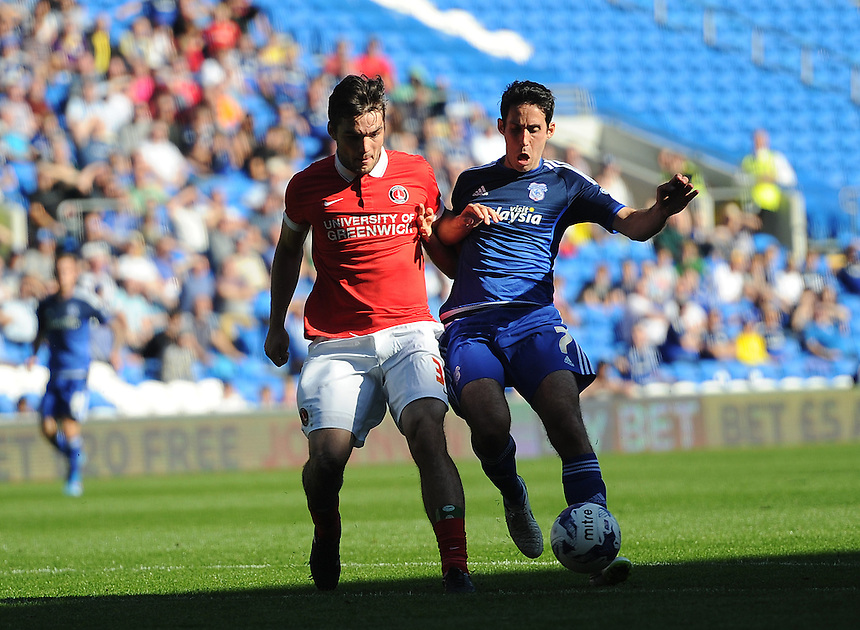 Charlton Athletic's Tony Watt vies for possession with Cardiff City's Peter Whittingham <br /> <br /> Photographer Ashley Crowden/CameraSport<br /> <br /> Football - The Football League Sky Bet Championship - Cardiff City v Charlton Athletic - Saturday 26th September 2015 - Cardiff City Stadium - Cardiff<br /> <br /> &copy; CameraSport - 43 Linden Ave. Countesthorpe. Leicester. England. LE8 5PG - Tel: +44 (0) 116 277 4147 - admin@camerasport.com - www.camerasport.com