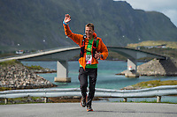 Runner passing Fredvang bridges, Lofoten Ultra Marathon, 2016