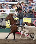 Russell Cardoza competes in the team roping event at the Reno Rodeo in Reno, Nev. on Friday, June 19, 2015.<br /> Photo by Cathleen Allison/Nevada Photo Source