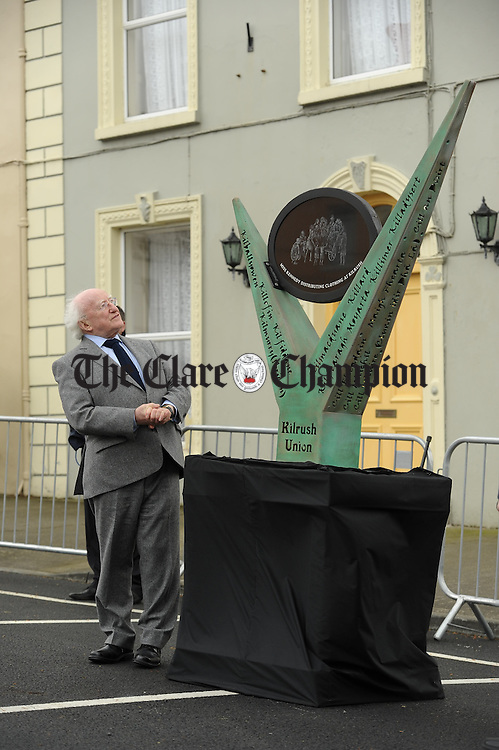 President Michael D Higgins unveils a sculpture during the National Famine Memorial Day Commemoration ceremony at Kilrush. Photograph by John Kelly