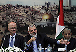 Senior Hamas leader Ismail Haniyeh speaks during the visit of Palestinian Prime Minister Rami Hamdallah, at Haniyeh's house in Gaza city on October 9, 2014. The Palestinian unity government which took the oath of office in June under technocrat prime minister Rami Hamdallah arrived to Gaza Strip on Thursday to convene the first fully meeting. Hamdallah said that the unity government will rebuild the bombed-out Gaza Strip following a seven-week Israeli offensive. Photo by Ali Jadallah