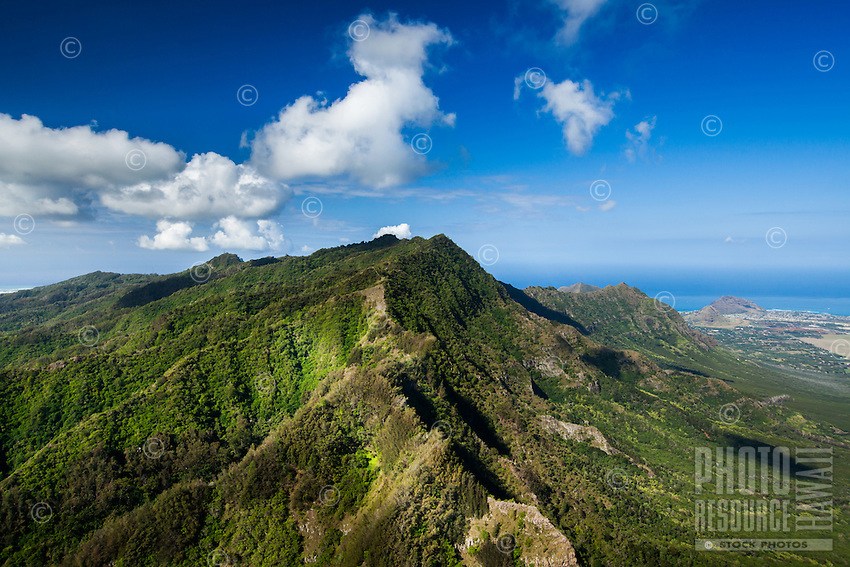 An aerial view of lush green mountains, West O'ahu.