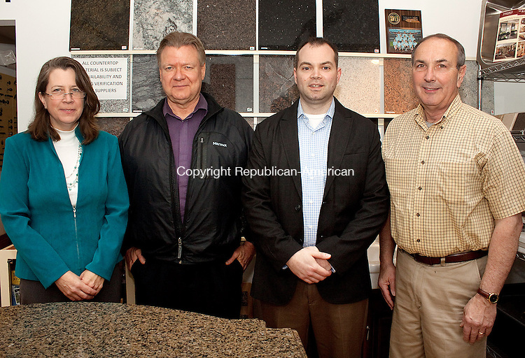 TORRINGTON, CT- MAY 09  2011-050912DA04-Members of Chamberlin Granite Co. in Torrington, from left, Laura Day, design representative,  John Yates, Senior designer, Tyson Chamberlin, co-owner and Ken Byrne, memorialist stand next to several samples of granite inside the business on Wednesday. Darlene Douty Republican American