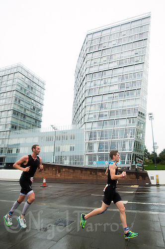 10 AUG 2014 - LIVERPOOL, GBR - Competitors run along the Strand during the Tri Liverpool triathlon which incorporated the 2014 British Age Group Triathlon Championships in Kings Dock in Liverpool, Great Britain (PHOTO COPYRIGHT © 2014 NIGEL FARROW, ALL RIGHTS RESERVED)