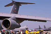 US Air Force Military Aircraft on Static Display - at Abbotsford International Airshow, BC, British Columbia, Canada - Lockheed C-5 Galaxy Cargo Transporter in foreground