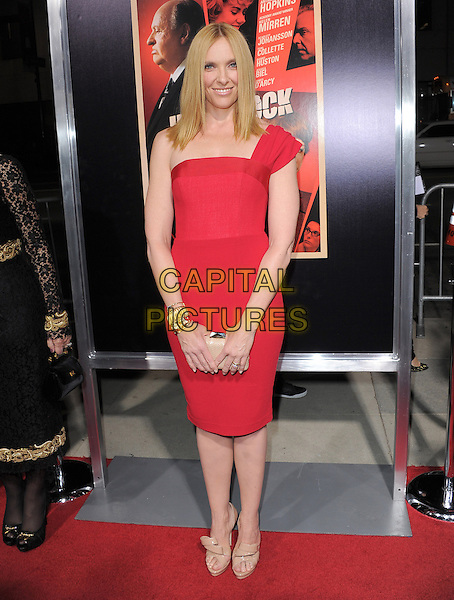 "Toni Collette.""Hitchcock"" Los Angeles Premiere held at the AMPAS Samuel Goldwyn Theater, Beverly Hills, California, USA.  .November 20th, 2012.full length red one shoulder dress beige nude clutch bag shoes .CAP/RKE/DVS.©DVS/RockinExposures/Capital Pictures."
