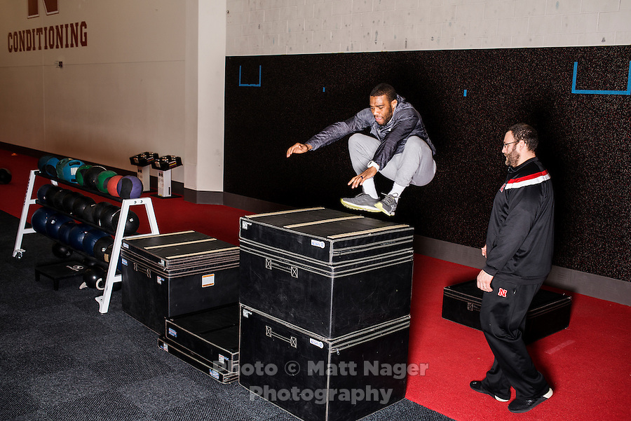 Olympic Gold champion wrestler Jordan Burroughs (cq), works with strength coach Brian Kmitta (cq) during a training session at the University of Nebraska in Lincoln, Nebraska, Friday, February 12, 2015. Burroughs is training for the upcoming 2016 olympic games in Rio de Janeiro, Brazil where he hopes to win another gold medal. <br /> <br /> Photo by Matt Nager