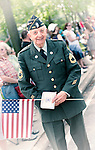 American Legionnaire marching in Merrick Memorial Day Parade and Ceremony on May 28, 2012, on Long Island, New York, USA.  Veteran is a member of American Legion Merrick Post 1282, which hosted the parade and ceremony. America's war heroes are honored on this National Holiday. NOTE: vintage treatment