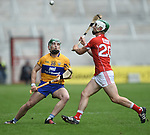 Mikey O Malley of Clare in action against Shane Kingston of Cork during their Munster Senior game at Pairc Ui Chaoimh. Photograph by John Kelly.